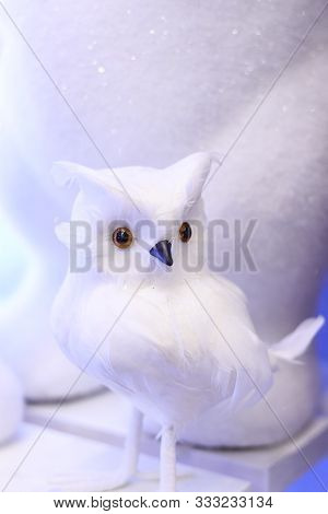 Small Owl Toy On A White Background. Winter Holidays Christmas Party Home Decoration