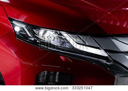 Novosibirsk, Russia - October 10, 2019:  Mitsubishi L200 , Red Car Headlights. Exterior Detail. Clos