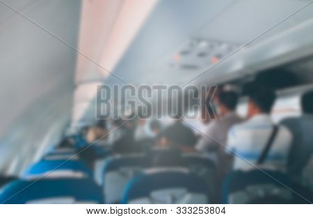 Blurred Defocused Image Of Many People On Passageway And Looking For Seat In The Planes. Stock Photo