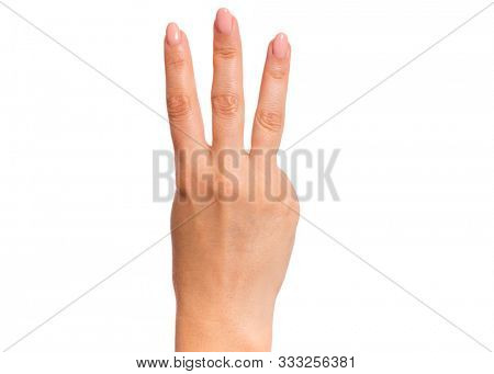 Female hand showing 3 fingers gesture, isolated on white background. Beautiful hand of woman with copy space. Hand doing gesture of number Three. Series of photos count from 1 to 5.