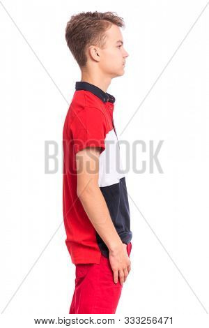Handsome happy teen boy - side view, isolated on white background. Photo of adorable young smiling child looking at camera, front view. Emotional portrait of caucasian teenager - profile.