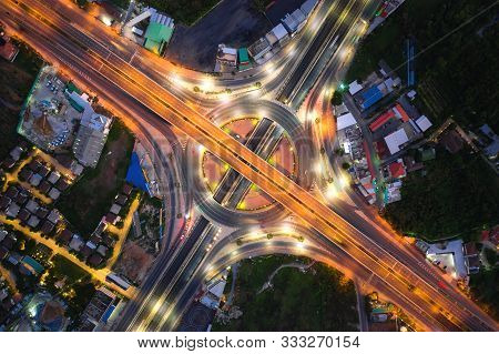 Aerial View Of Highway Junctions Top View Of Urban City, Bangkok At Night, Thailand. Light Trails Ac
