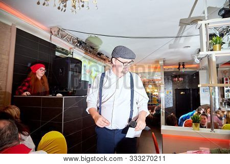 Kirov, Russia - October 10, 2019: Actor Performing With Microphone In Small Cafe Or Restaurant