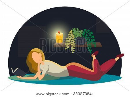 Beautiful Blonde Woman Lying Down Reading A Book. Adorable Young Woman Spending Weekend At Home. Lei
