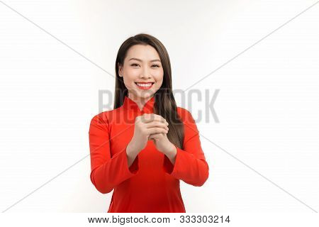 Beauty Woman Wear Red Ao Dai And Feel Excited With Lunar New Year (tet Holiday)