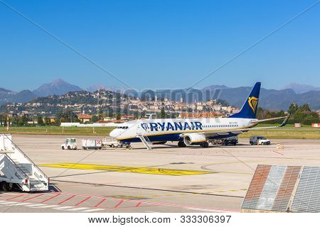 Bergamo, Italy - October 26, 2019: Ryanair plane waiting for boarding on Bergamo Airport in Italy. Ryanair is the biggest low-cost airline company in Europe.