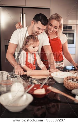 Beautiful Family Bake Christmas Cookies. Family Cooks In The Kitchen. Holidays. Christmas. New Year.