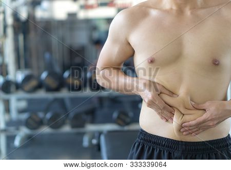 Close Up Man Holding Excessive Fat Belly. Man Overweight Abdomen. Man Diet Lifestyle Concept Reduce