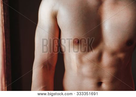 Strong Athletic Asian Man Showing Muscular Body And Sixpack Abs In Close-up Shot.