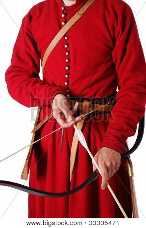 Close-up Of Bow With Arrow In Male Hands.