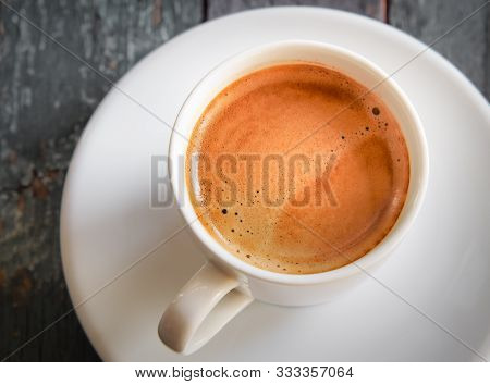 Hot Espresso Coffee Cup On Wooden Table. Fresh Hot Coffee By Top View.