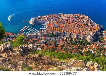 Aerial View Of The Old Town Of Dubrovnik With City Wall, Towers, Forts And Old Harbour In Dubrovnik,
