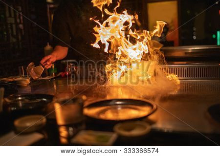 Teppanyaki Chef Cooking With Flames