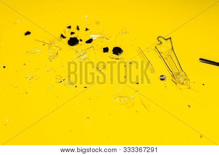 Splinters From The Glass Light Bulb Isolated On Yellow Background