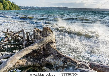 Wave From The Puget Sound Hit Rocks On The Shoreline In Des Moines, Washington.