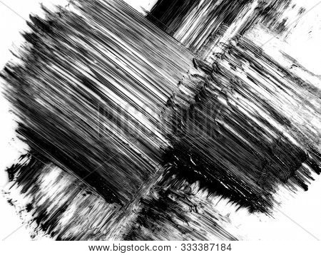 Black strokes and texture mascara or acrylic on a white background. Texture of black mascara for eyelashes isolated on white background. Smear of black mascara for eyelashes on white. Mascara smears