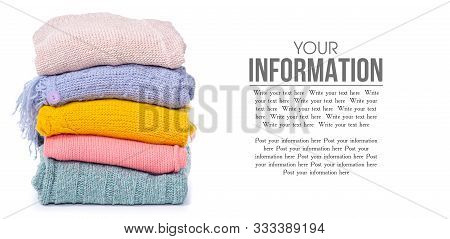 Stack Color Sweaters On White Background Isolation, Space For Text