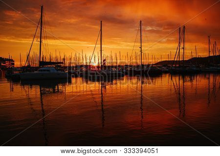 Sunrise In Atractive Northern France, City Binic. Strong Contrast And Glittering Orange.