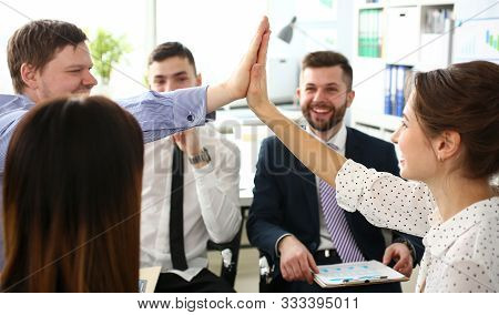 Group Of Businessman And Businesswoman Celebrating Victory And Teamspirit Giving High Five In Air Cl