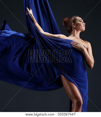 Slim Girl Wrapped In Blue Aerial Silks