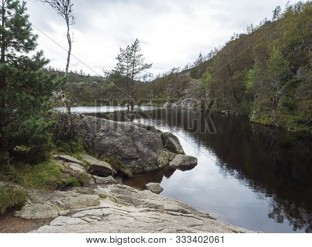 View On Small Water Pond Or Lake On Hike To Preikestolen Massive Cliff Famous Norway Viewpoint Moody