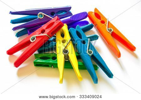 Colorful Clothes-peg Isolated On White Background