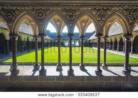 Cloister Of The Abbey Of Mont Saint Michael Formed By A Succession Of Columns And Arches.