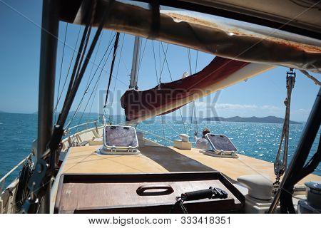 Nautical Vessels Prow Sailing On A Blue Sea