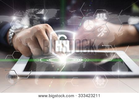 Business Protection Secure And Encryption Internet Technology Concept. Businessman Use Smart Pad Wit