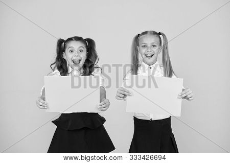 Genius Advertising And Marketing. Happy Genius Children Holding Blank Paper Sheets On Yellow Backgro
