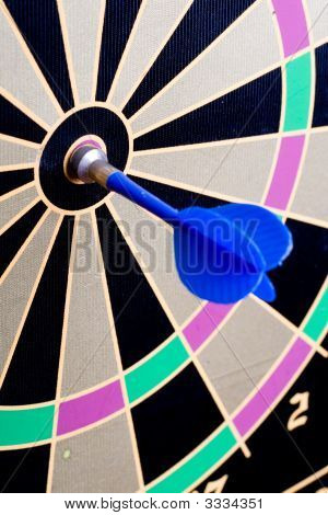 A Magnetic Dart Board With A Dart
