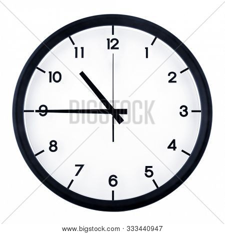 Classic analog clock pointing at ten forty five o'clock, isolated on white background.