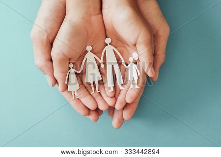 Adult And Children Hands Holding Paper Family Cutout, Family Home, Foster Care, Homeless Charity Sup