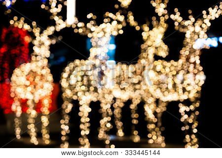 Christmas Reindeer With Golden Twinkling Lights Bokeh. Snowflake On Bright Background.beautiful Nigh