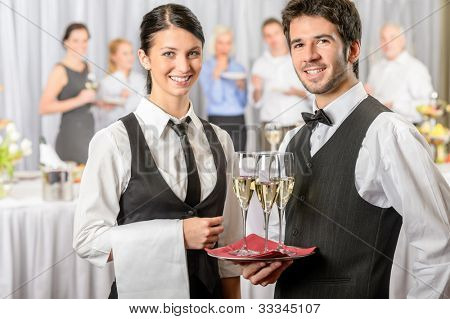 Professional catering service business event serving drinks to guests