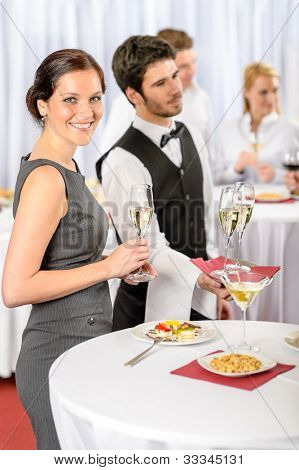 Catering service at business meeting offer champagne aperitif to woman