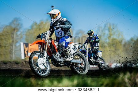 Motocross Racing Two Motorcycle Racer Riding On Muddy Track