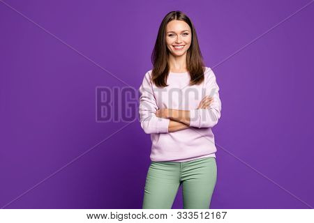 Photo Of Cheerful Positive Cute Nice Charming Girl Standing Confidently With Hands Folded Isolated O