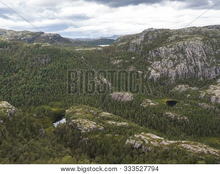 View On Landscape With Forest, Lakes And Mountain On Hike To Preikestolen Massive Cliff Famous Norwa