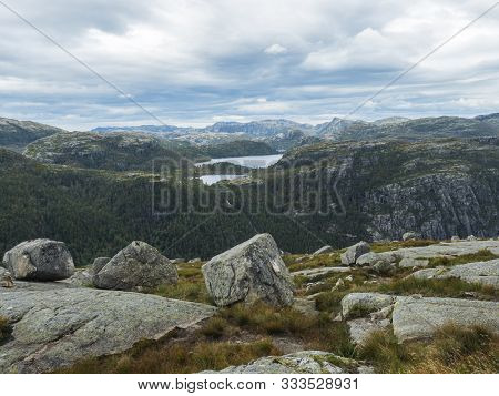 View On Landscape With Rock, Blouders, Stone And Lysefjord On Hike To Preikestolen Massive Cliff Fam