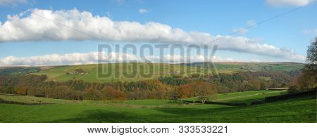 Wide Panoramic View Of West Yorkshire Countryside With The Forest Of Hardcastle Crags In The Bottom