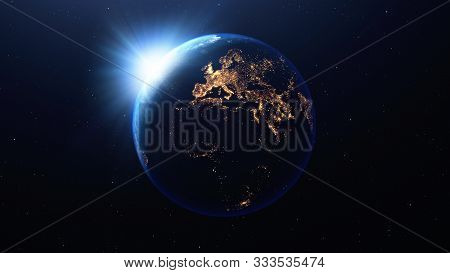 Earth Planet With Sun Viewed From Space At Night Showing The Lights Of Europe , America And Other Co