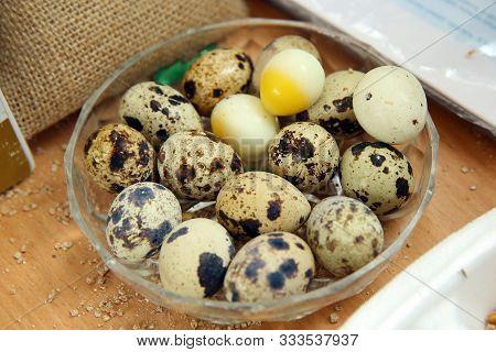 Quail Eggs In A Glass Bowl Top View . Quail Eggs In A Glass Bowl . The Quail Eggs Are In The White G