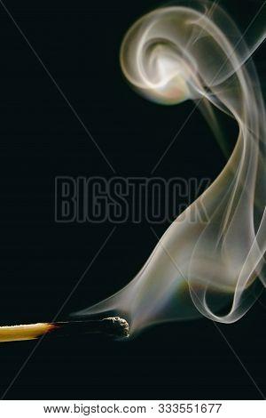 Match Stick With Burnt Head And Smoke Around