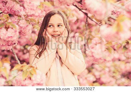 Allergy Remedy. Sniffing Flowers. Girl Enjoying Floral Aroma. Pollen Allergy Concept. Kid Enjoy Cher