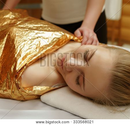 Caring About Beauty. Body Wraps In Spa Salon
