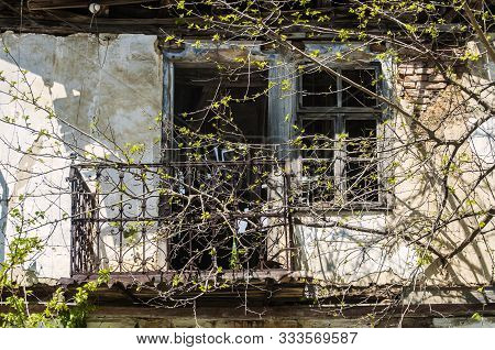 Facade With Balcony Of Old Neglected Abandon Village House