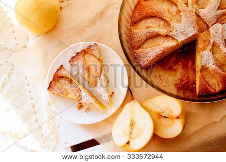 Two Cake Pieces Of Pear Pie On White Plate With Fresh Pears In Background. Pear Tatin Pie On White W