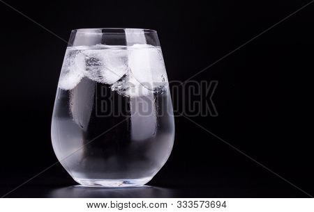 Big Glass Of Water With Ice Cubes, Black Background