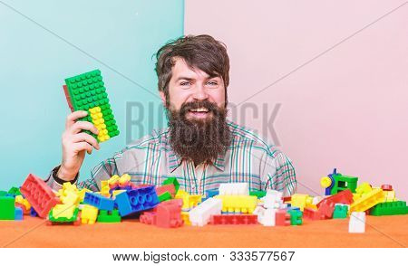Just Relax. Happy Father Play Game. Bearded Hipster Man Playing Toy Blocks. Development. Leisure Tim